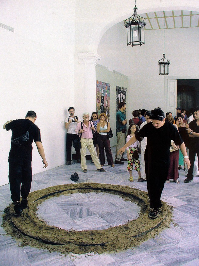 Equilibrium, 1998-2002 / Performance and cast bronze object, sand and steel / Dimensions variable