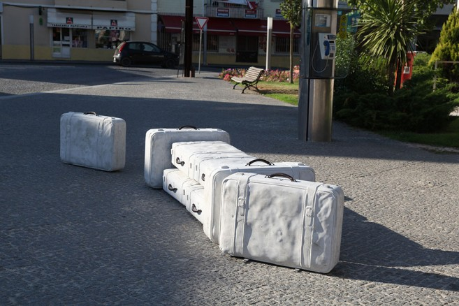 In tran-sit, 2002-2010 / Cast solid concrete and bronze / Life size suitcases