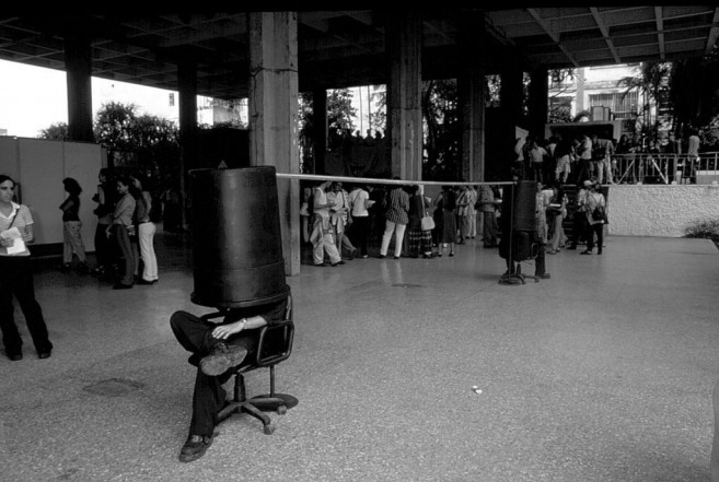 Secreter (with Iván Capote), 1999 / Performance with chairs, metal and plastic objects