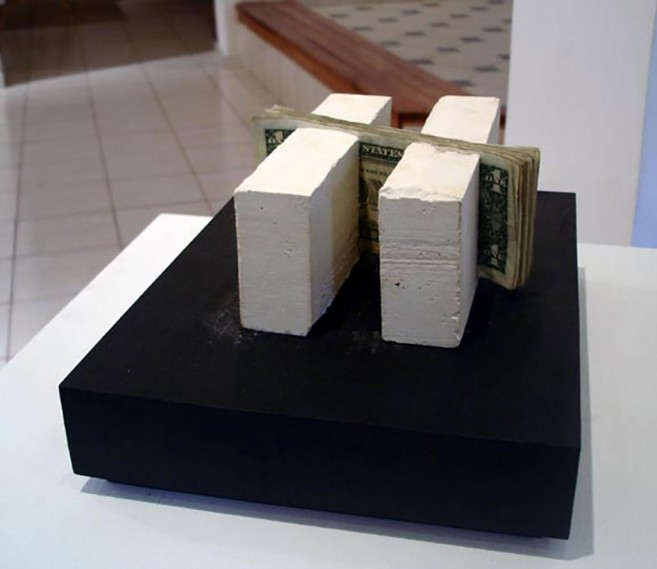 Intrinsic, 2006 / Plaster and dollar bills / 7 x 17 x 16 cm