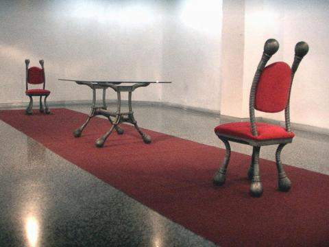 Protocol, 2001 / Cast aluminum, red velvet, glass, carpet ,and sound / Variable dimensions