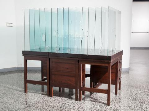 Bureaucratic, 2006-2011 / Wooden office desks and glass / 102 x 104 x 180 cm