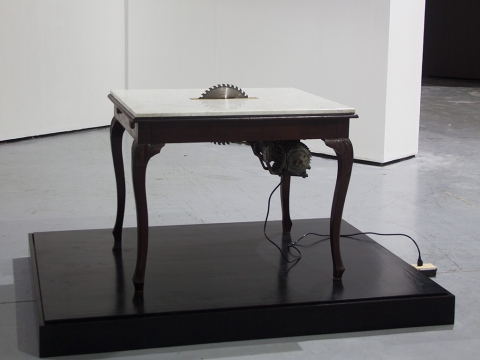 Diplomacy Lesson (agreement table), 2015 / wood, marble, motor and saw blade mechanism / 88 x 101.5 x 89 cm