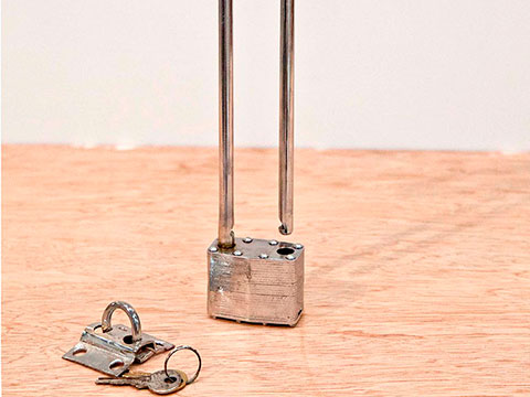 Faith, 2013 / Nickel-plated metal and padlock / 31 x 22 x 3 cm